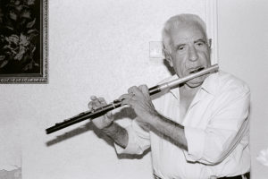 bl000567-Mitsos-playing-flute